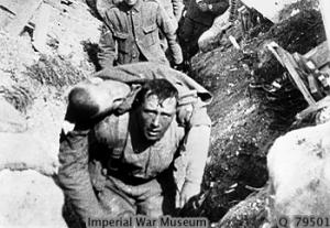 """Tommy rescuing a comrade under shell-fire"""