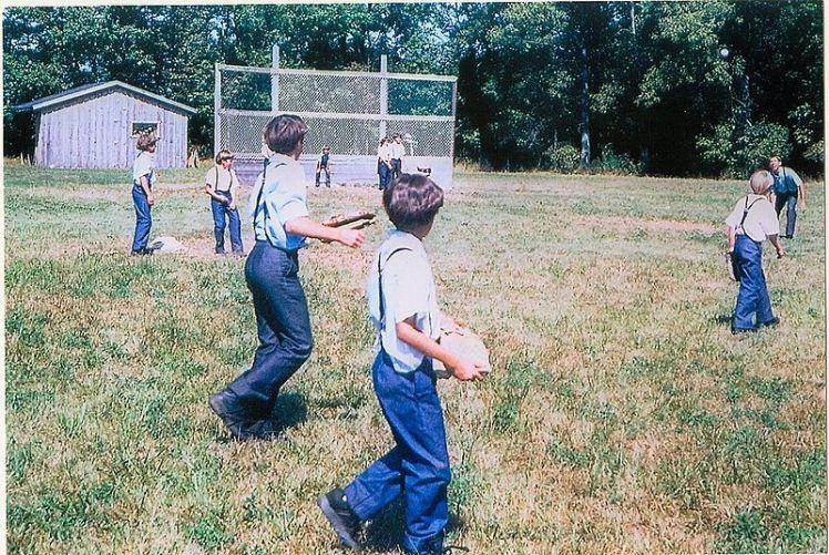 Amish children playing baseball