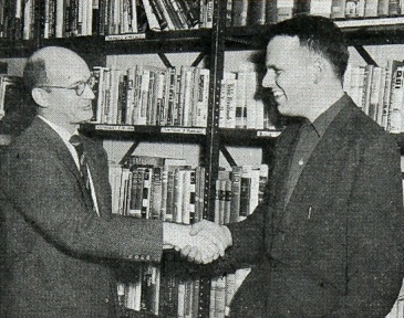 Walfred Peterson (with history professor Dalphy Fagerstrom) on completing his doctorate in December 1957