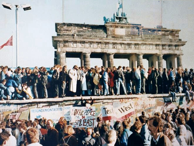 Protestors standing on the Wall in 1989