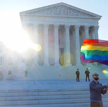 Rainbow flag waving before Supreme Court in April 2015