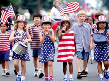 Children marching in a 4th of July parade