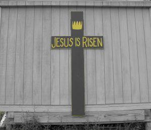 """Wooden cross inscribed, """"Jesus is Risen"""""""