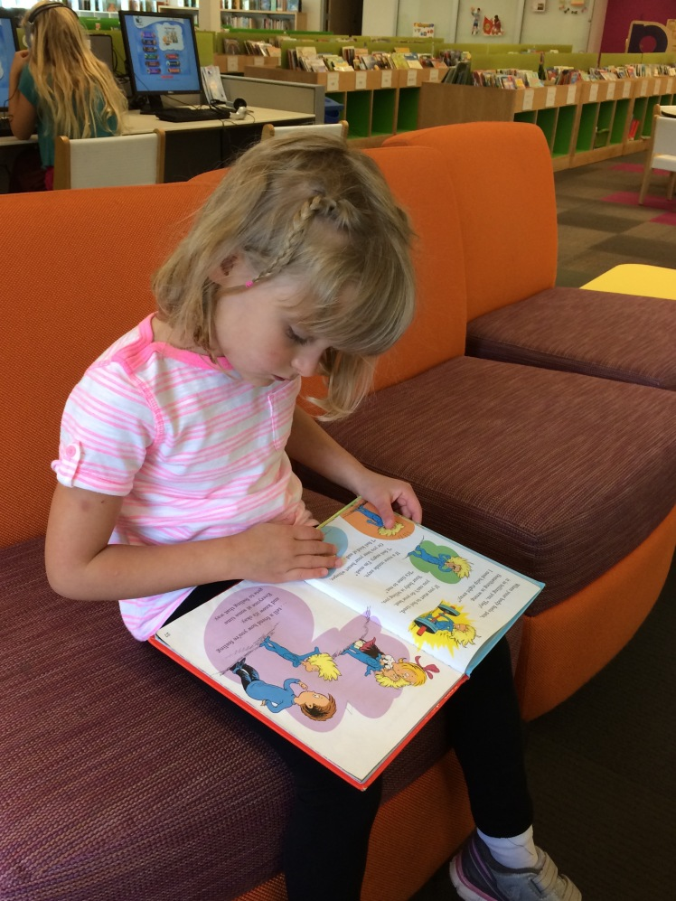 Lena reading in our local library