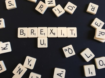 Scrabble tiles forming Brextit and EU