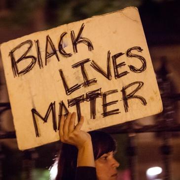 """Black lives matter"" sign at Philando Castile protest in St. Paul, MN"