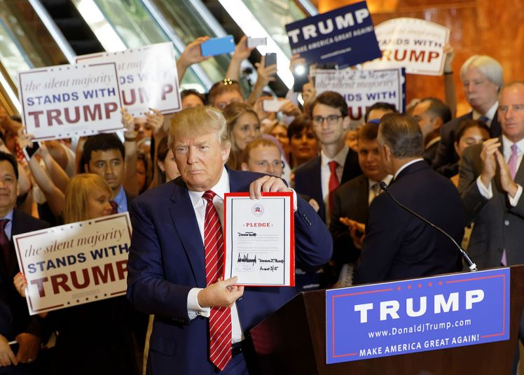 Sept. 2015 photo of Trump signing a pledge to support the GOP nominee