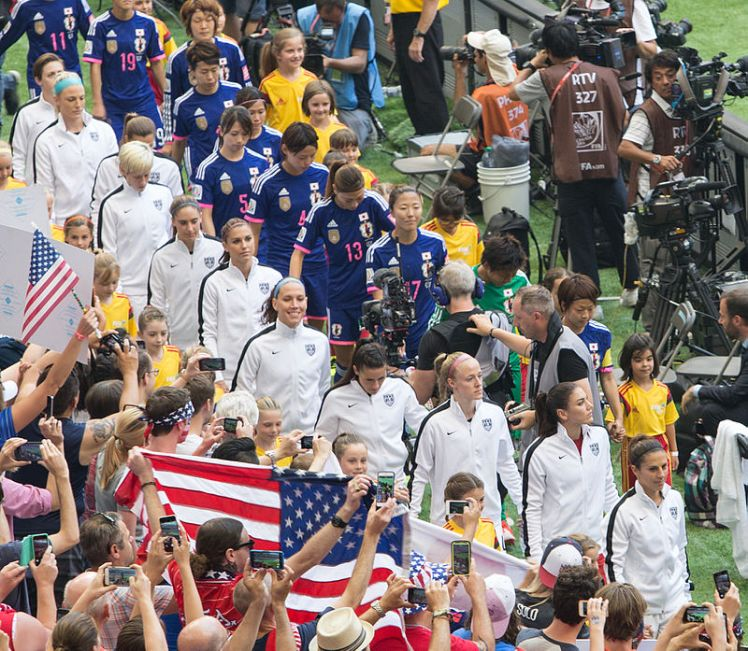 American and Japanese players before the championship match of the 2015 FIFA Women's World Cup
