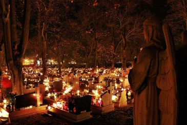 Polish graves lit with candles for All Saints' Day