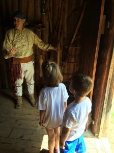 The kids listening to a voyageur at the NW Company Fur Post