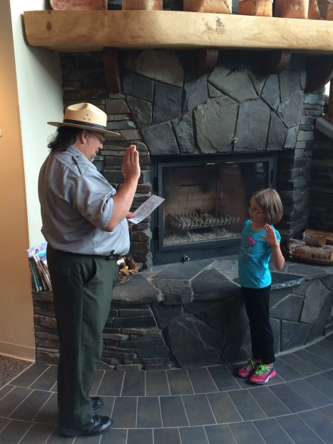 Lena becoming a junior ranger at Grand Portage