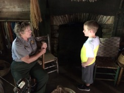 Isaiah with a Park Ranger at Mabry Mill