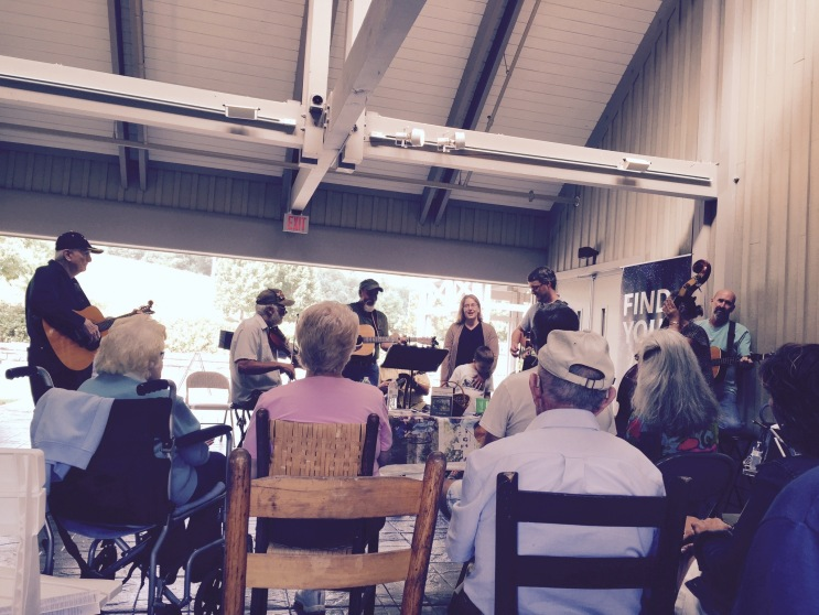Me playing guitar with a bluegrass band at the Blue Ridge Music Center