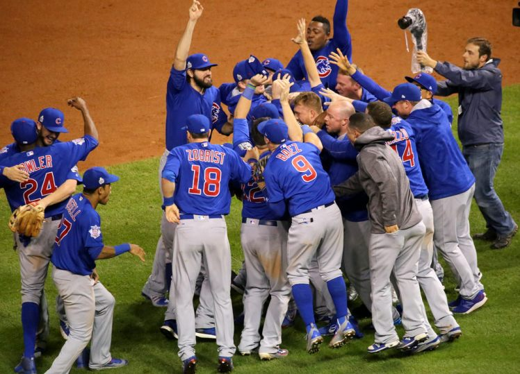 Chicago Cubs players celebrating in the infield after winning the 2016 World Series