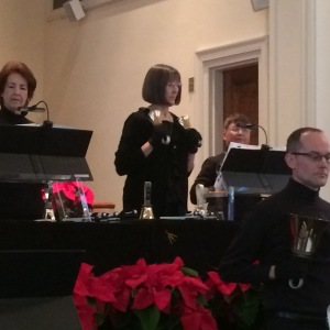 Mom ringing hand bells earlier this month
