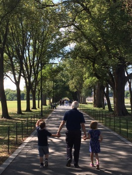 My kids and my dad walking to the Lincoln Memorial in Washington, DC