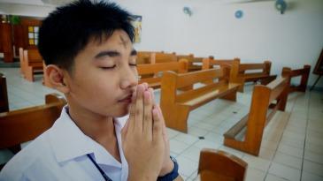 Man praying, with ashes