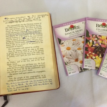 Glen's book of worship, seeds, and gardening gloves