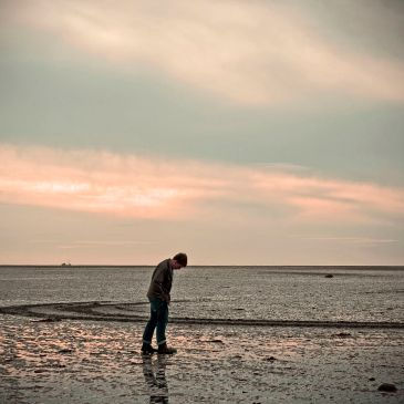 Image of man alone on a beach