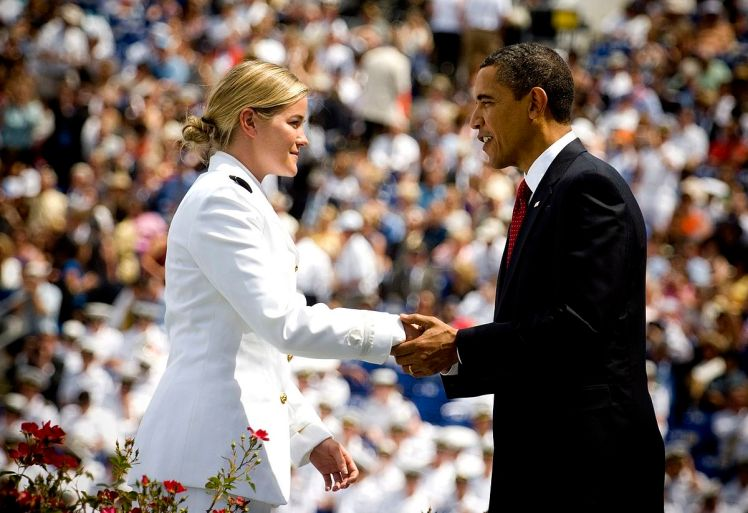 Barack Obama congratulating a new naval ensign in 2009
