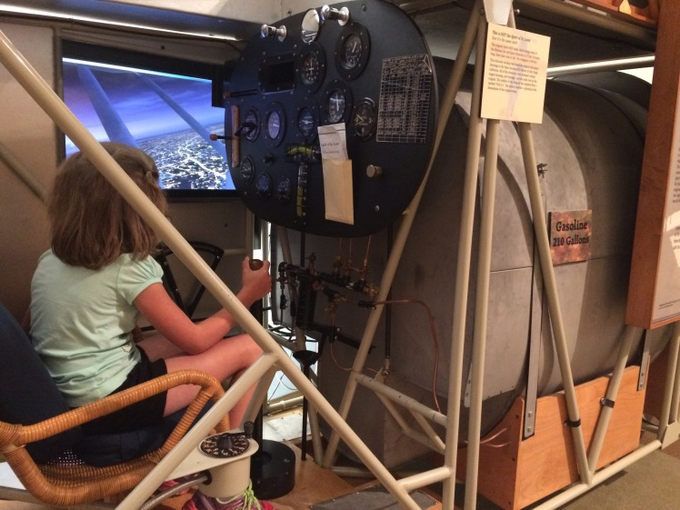 My daughter in the Spirit of St. Louis flight simulator at the Lindbergh Historic Site
