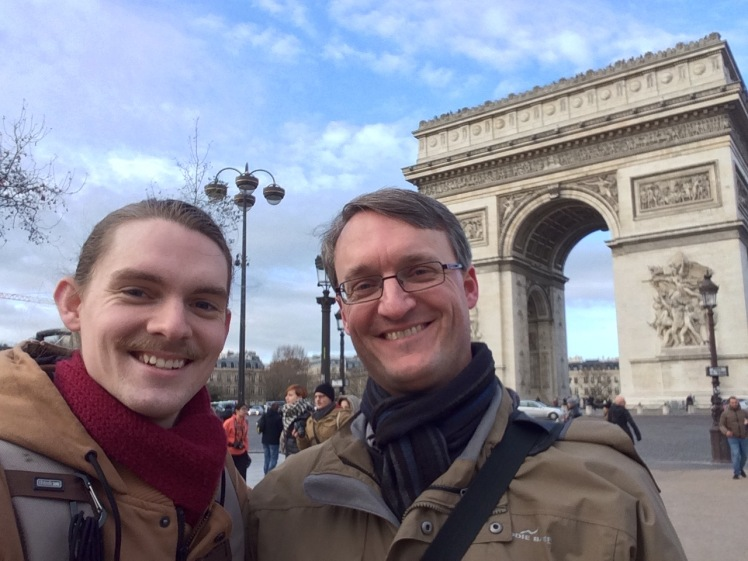 Connor Larson and me in front of the Arc de Triomphe