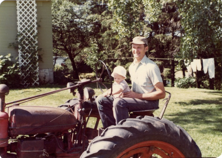 Grandpa Peterson and me on his tractor