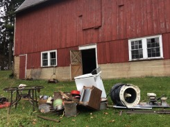The scrap metal heap grows, next to the barn