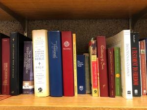 Bibles, hymnals, prayer books above my laptop