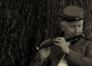 Civil War reenactor playing a fife