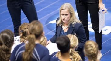 Gretchen Hunt coaching Bethel University's women's volleyball team