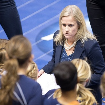 Gretchen Hunt coaching Bethel University's women's volleyball team