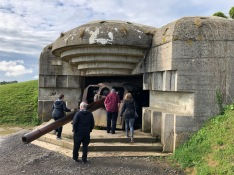 Visiting a former German artillery battery at Longues-sur-Mer, overlooking the beaches of Normandy