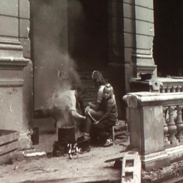 """Still photo from the 1946 documentary, """"A Defeated People"""": children in the ruins of a German building"""