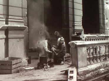"Still photo from the 1946 documentary, ""A Defeated People"": children in the ruins of a German building"